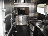Restaurant car WRmh 132. Permitted for speed up to 200km/h. Large kitchen area for preparation of excellent meals prepared on the train. Restaurant car in operation at Contintal Railway Services in Hungaria and heading for different international destinations.